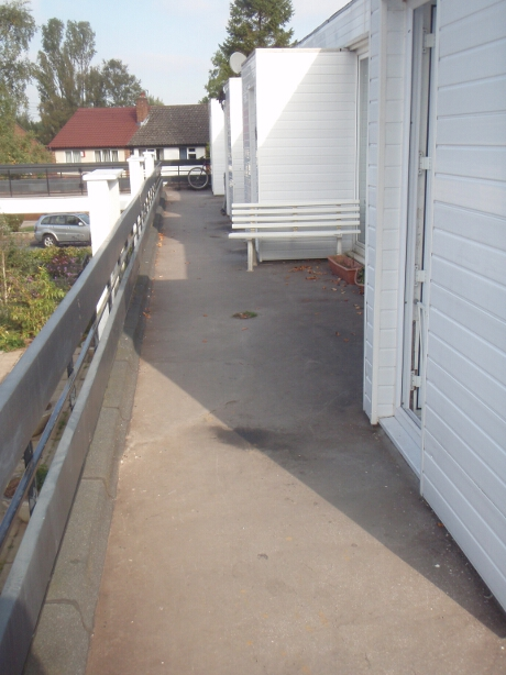 asphalt walkway before Liquid Roofing